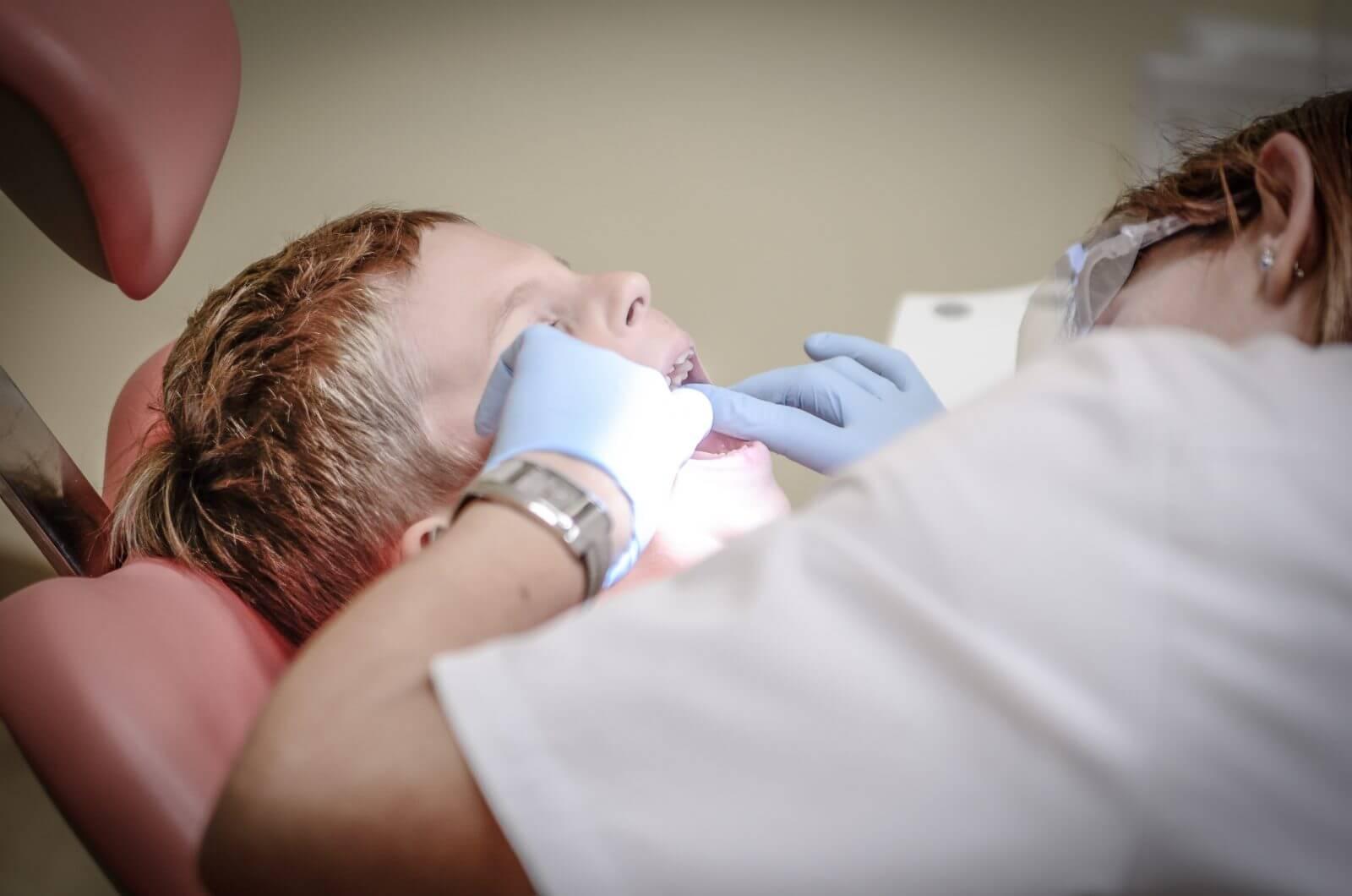 dentist examining a boy